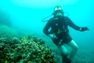 diver in palau over B24 wreck