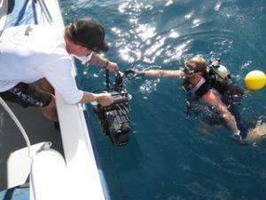 handing off the navigator sonar to diver on bentprop crew in palau