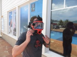 Derek trying on new full face dive mask with bentprop palau