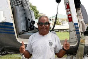 standing in front of a helicopter, palau