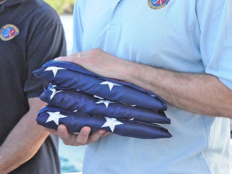 Three folded U.S. flags
