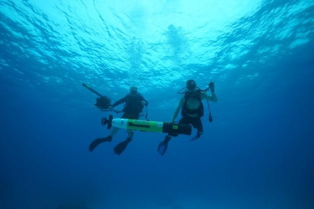Autonomous Underwater Vehicle and Project Recover personnel performing fieldwork in Palau.