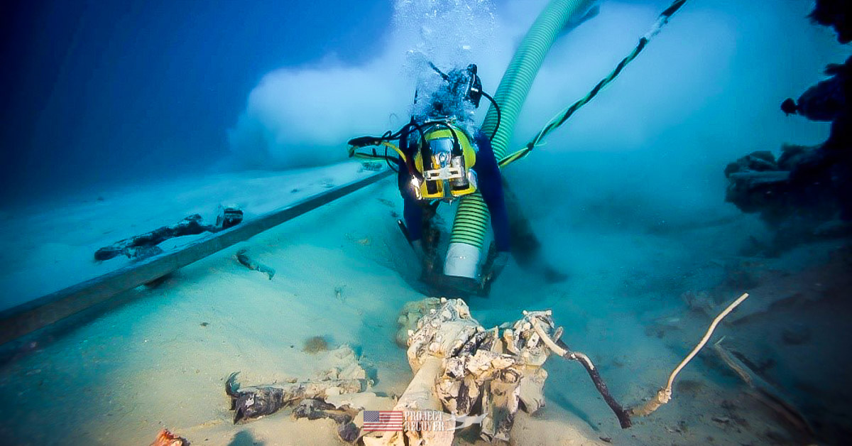 """Navy diver dredging for WWII MIA Avenger crew Walter E. """"Bert"""" Mintus and Lt. Roland Richard Houle found by Project Recover"""