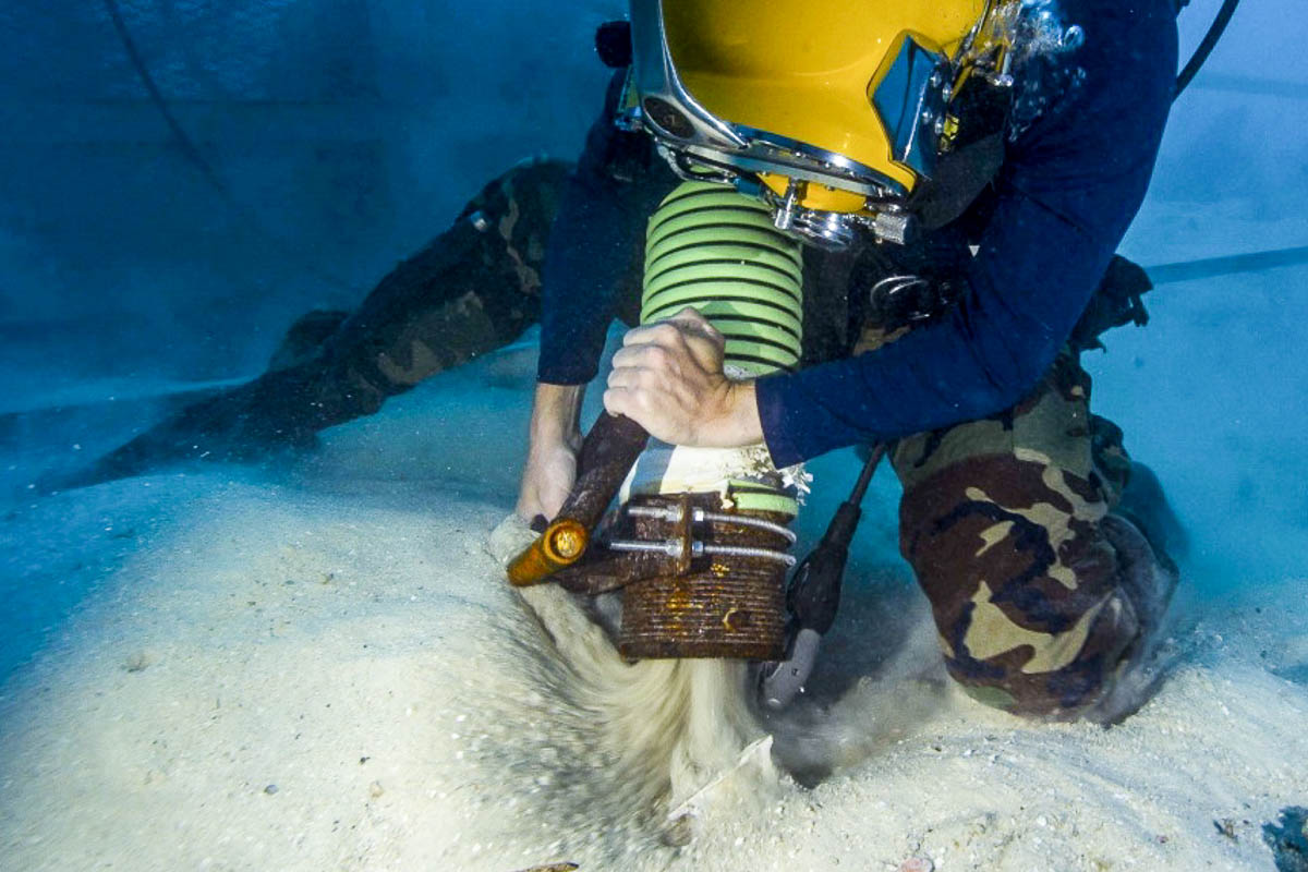 Navy diver vacuums sea bottom ending with WWII MIA Avenger & Hellcat Crew Remains Recovered