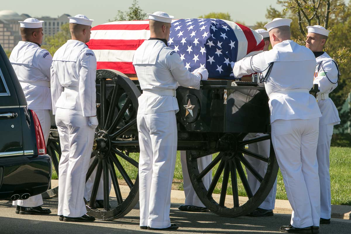 The casket of former WWII MIA pilot, Lt. Punnell, being secured on a caisson at Arlington National Cemetery. Photo: Harry Parker