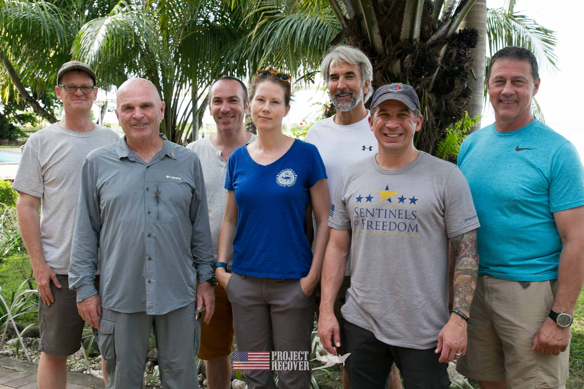 Project Recover Team Photo - From L to R: Ewan Stevenson (Solomon research specialist and guide), Dan O'Brien (team leader), Tony Burgess (survey assist), Megan Lickliter-Mundon (archeologist), Charlie Brown (camera assist), Derek Abbey (sonar assist), Jeff Lynett (sonar), not featured - Harry Parker (photographer) Scuba diving MIA crash sites - Project Recover and BentProp Project are committed to bringing the MIA home. Photos by Harry Parker Photography.com