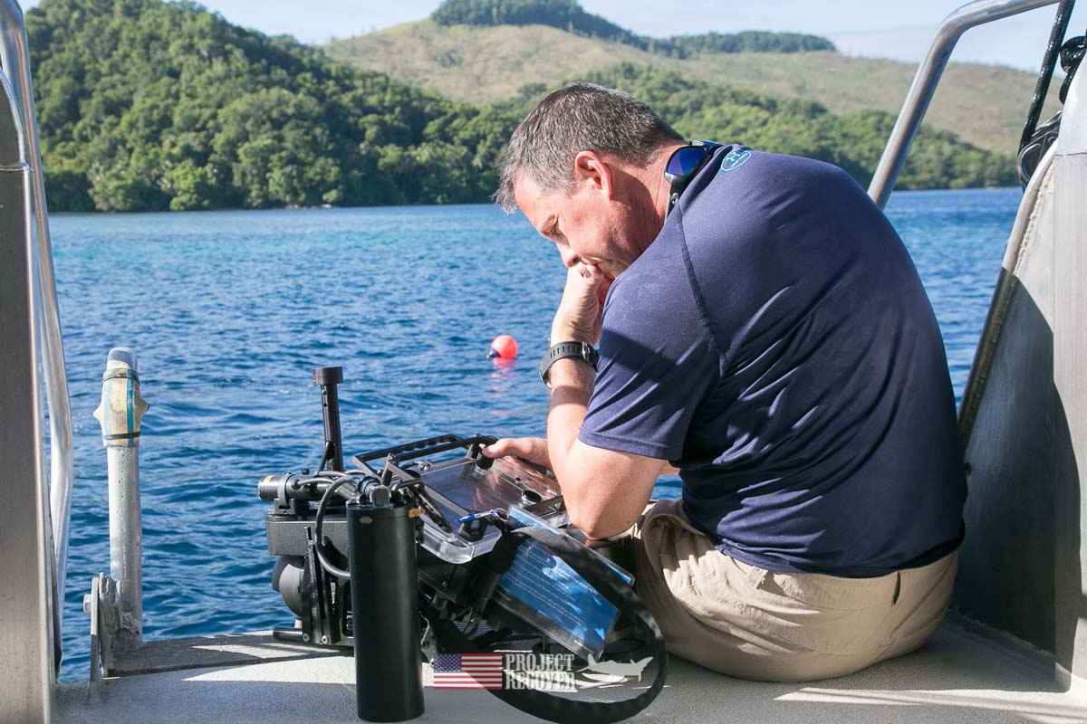 Jeff Lynett working on hand held underwater sonar for project recover during Solomons MIA Search - Project Recover and BentProp Project are committed to bringing the MIA home. Photos by Harry Parker Photography.com
