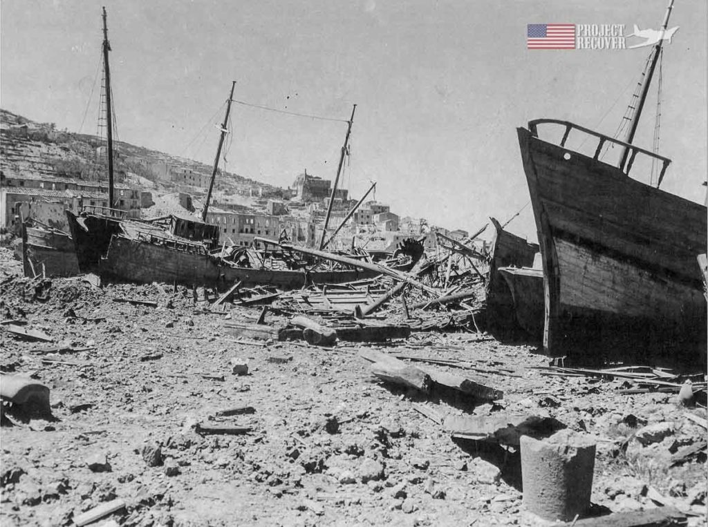 The destroyed shipping port of Porto Santo Stefano, Italy during WWII as Allied Forces fight to remove the Germans. - Project Recover is committed to bringing the MIA's home