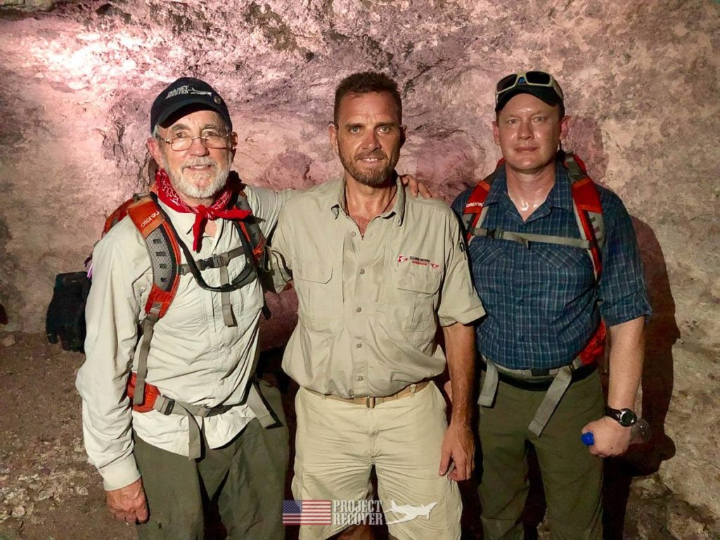 Pat Scannon (Project Recover President), Steve Ballinger (Cleared Ground Demining director), and Dave Bavencoff(Project Recover volunteer) in the limestone cave; a Japanese hideout in WWII.