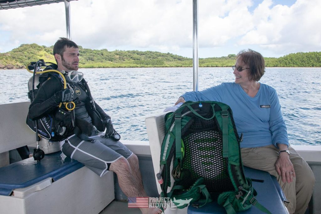 Adam talks to his mother, Cindy, (MIA Family) after dive to uncle's WWII plane wreck. Photo by Harry Parker Photography.com