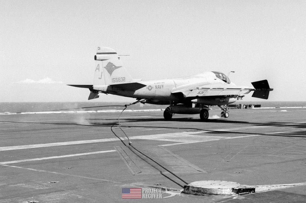 The tailhook of an A-6 catches on the arresting wire as it lands on the deck of an aircraft carrier. Photo Credit: US Navy archives/NHHC