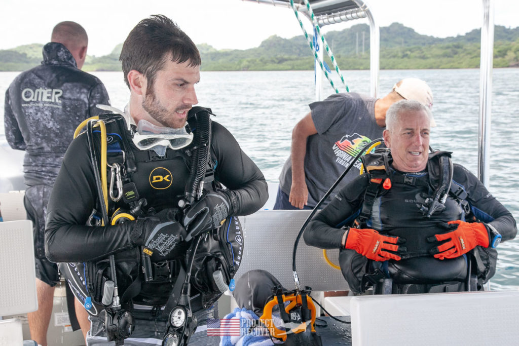 Adam Gray and Flip Colmer sit down after a dive on Adam's great-uncle ARM2c Albert 'Bud' Rybarczyk's downed WWII TBM Avenger.  Photo: Harry Parker Photography