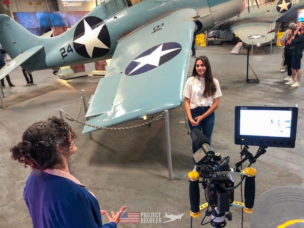 students aboard USS Midway being interviewed