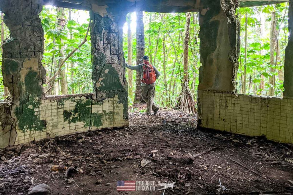 dr pat scannon looks towards jungle from a bombed out lighthouse palau