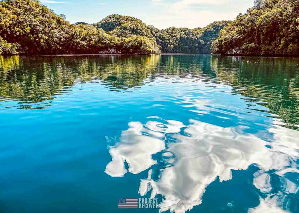 clouds refelect off the water in palau rock islands