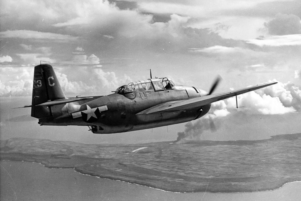 WWII TBM Avenger in flight over Pacific