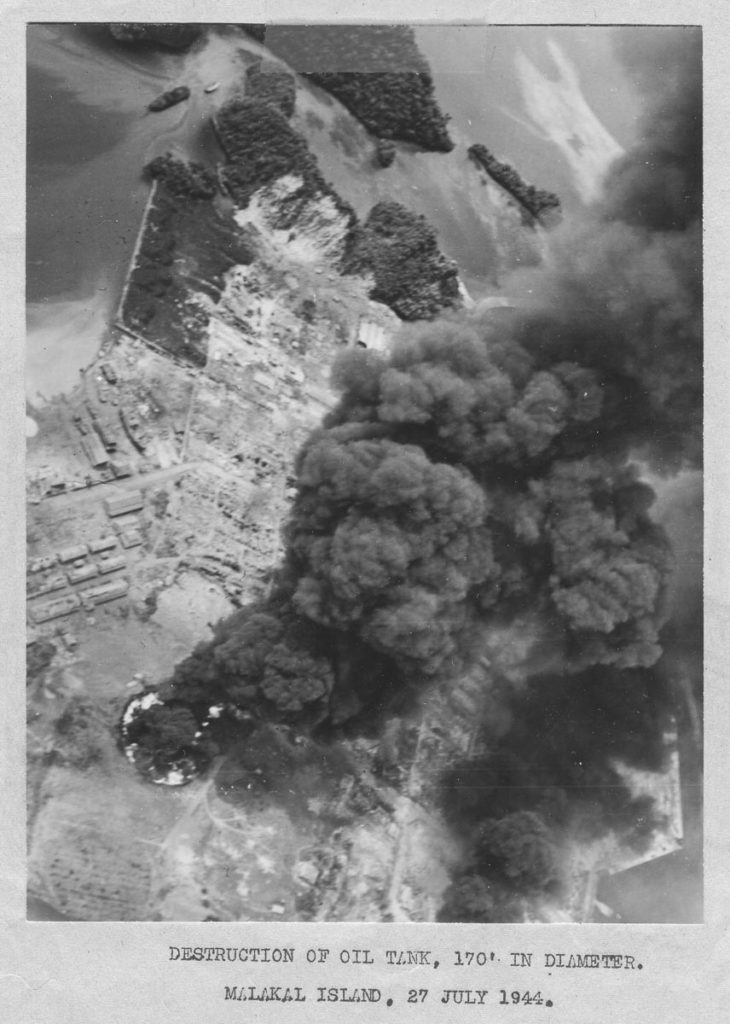 WWII Bombing Mission photo burning oil tanks
