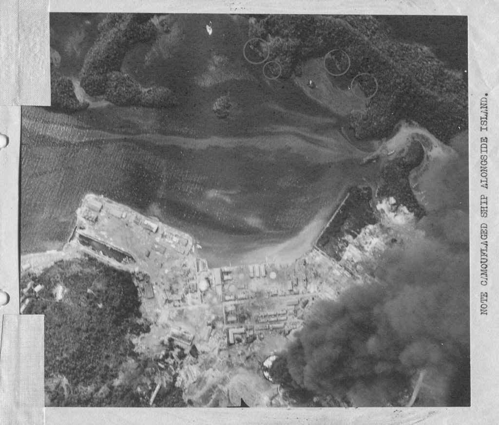 WWII Bombing MIssion Photo burning oil takes Palau