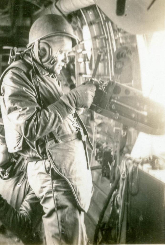 SSgt. Herbert Farnam, waist-gunner, shooting from B-24 WWII