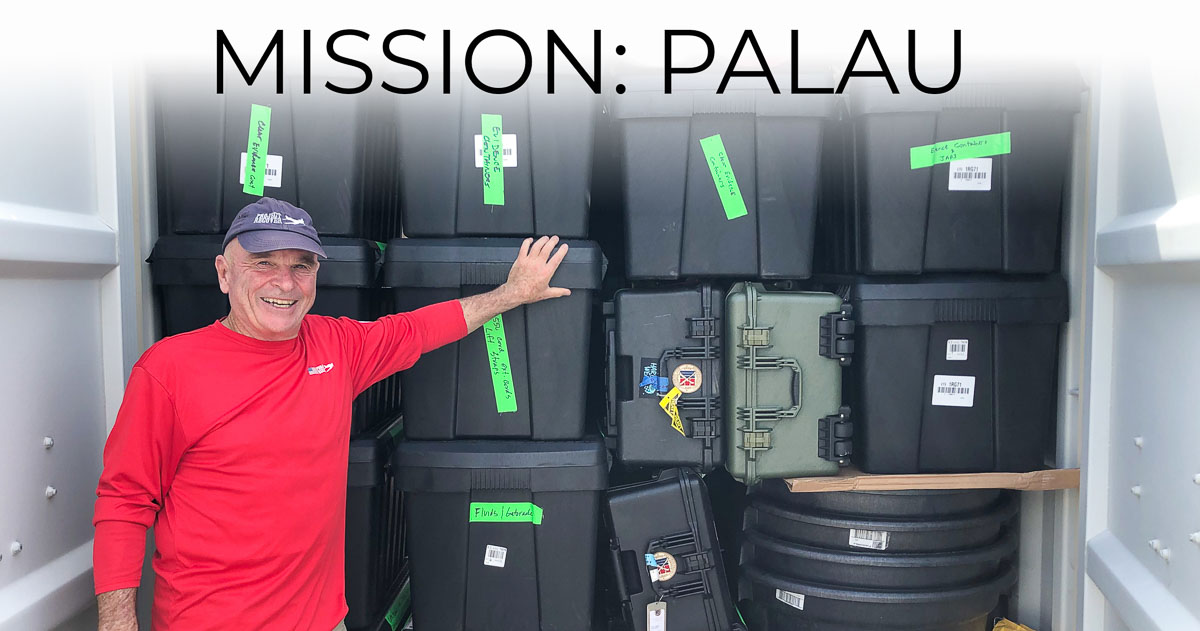 Dan O'Brien inn front of cargo container with supplies bound for MIA Recovery Mission in Palau.